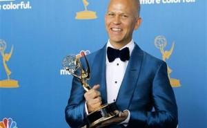 Ryan Murphy poses with his award for outstanding writing for a comedy series at the 62nd annual Primetime Emmy Awards in Los Angeles