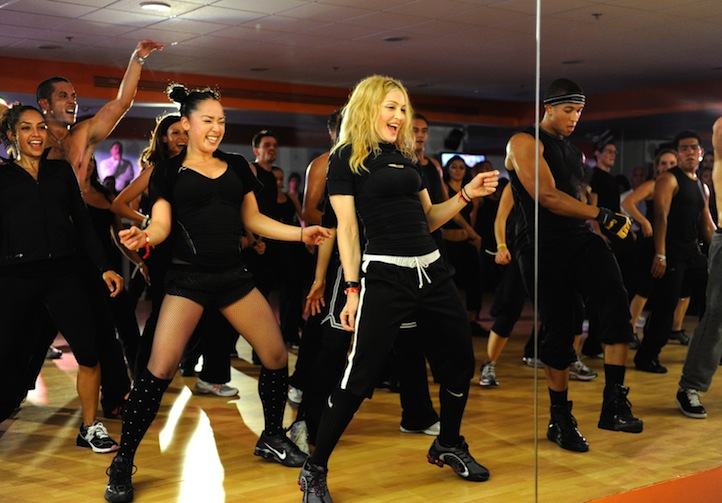 """* EXCLUSIVE * (Exclusive Coverage) Madonna teaches a class at the opening of Hard Candy Fitness on November 29, 2010 in Mexico City, Mexico. Madonna Opens """"Hard Candy Fitness"""" In Mexico City - Inside Hard Candy Fitness Mexico City, Mexico November 29, 2010 Photo by Kevin Mazur/WireImage.com To license this image (62645778), contact WireImage.com"""