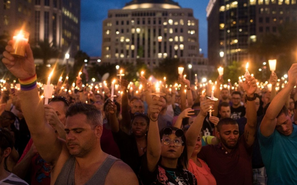 100612899_orlando_fl_-_june_13__people_hold_candles_during_an_evening_memorial_service_for_the_victi-xlarge_transwvbkyw-opmozj4yyfwrtqiggbxui0o2wdjuwyuyjkhe
